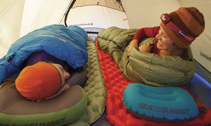 Two womens sitting in a tent on Sea to Summit Ultralight Mats