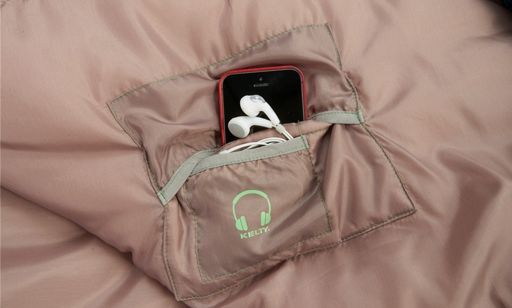 A phone in Kelty Tuck 30 Degree Sleeping Bag pocket