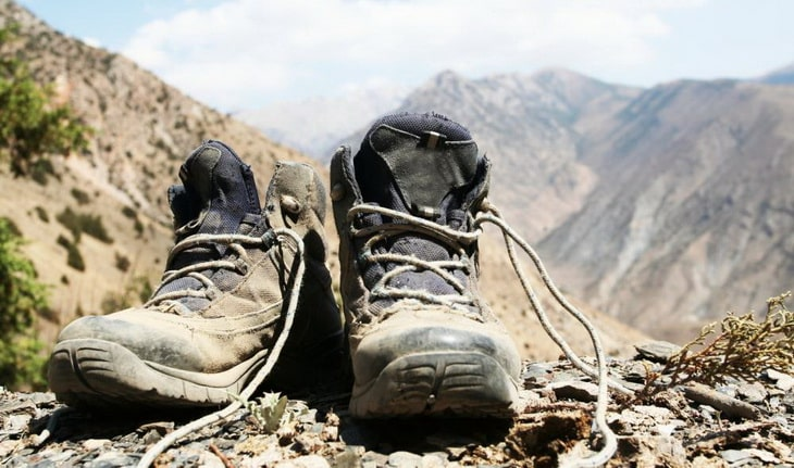 A pair of dirty hiking boots