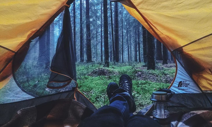 A man camping in the Igor-Cibulsky-Pine-Forest