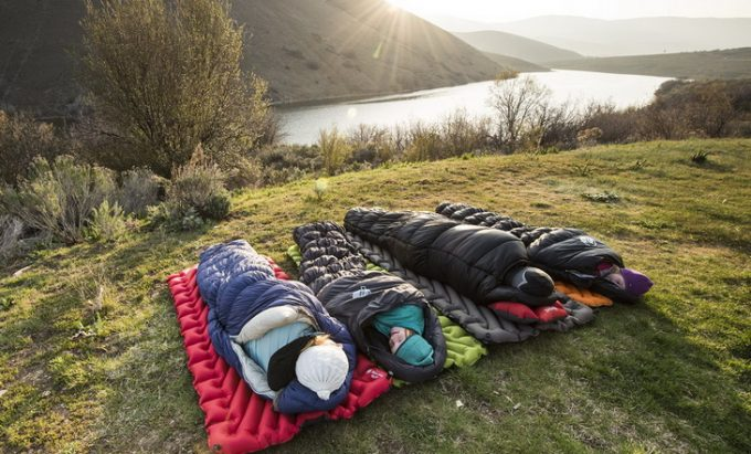 Four aduls in sleeping bags in the morning