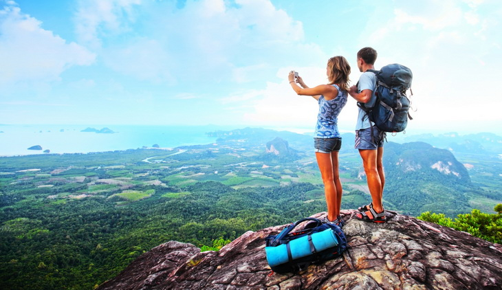 Backpackers on top of the mountains taking a selfie
