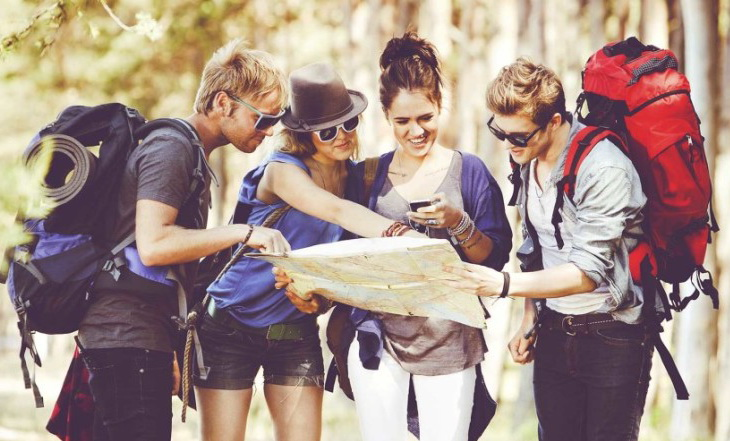 Backpackers looking at a map