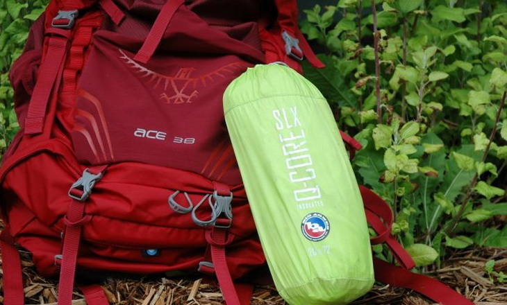 Big Agnes Sleeping Pad Q-Core SLX next to backpack