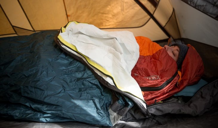 Woman sleeping in a tent with her face up