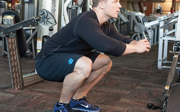 A Man Practicing Bosu Squat Exercise