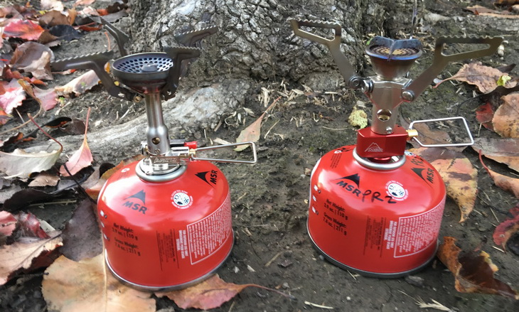 Canister gas stoves on the ground
