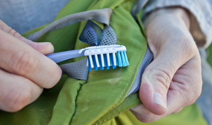Cleaning sleeping bag with a toothbrush