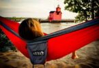 Woman relaxing in a ENO Eagles Nest Outfitters - DoubleNest Hammock