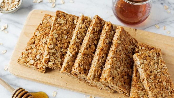 Energy bars on wooden cutting board