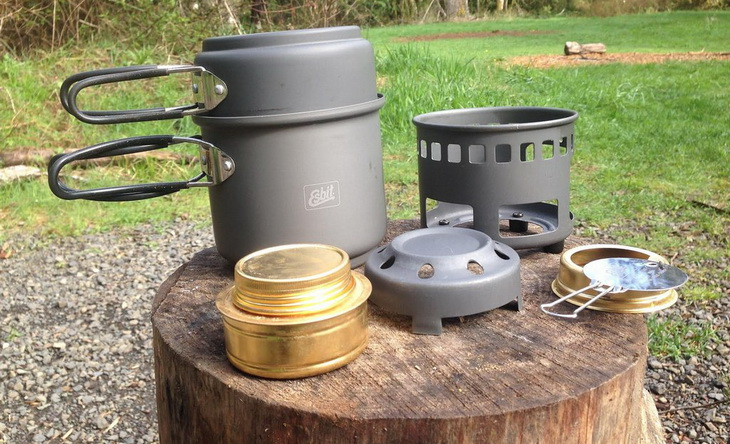 Someone preparing to cook with Esbit Alcohol Stove
