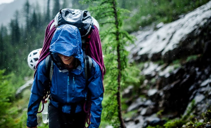 Woman hiking in the forest on a rainy day