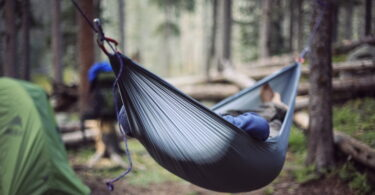 A person relaxing in the Grand Trunk Nano Hammock