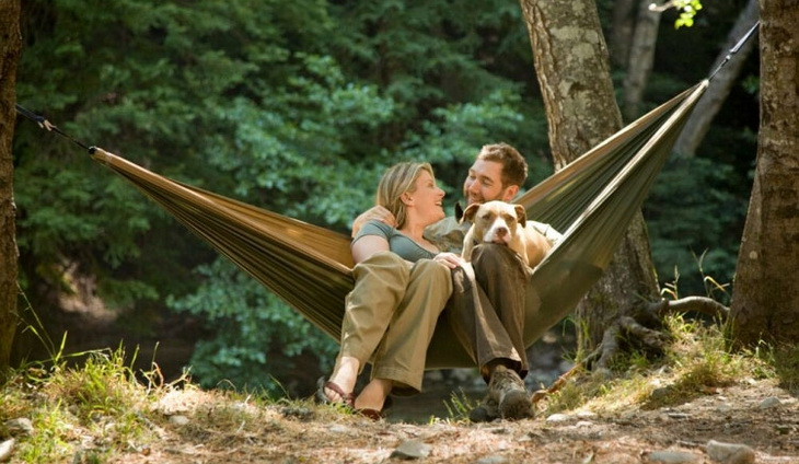 A couple enojoying the day in Grand Trunk Skeeter Beeter Pro Mosquito Hammock