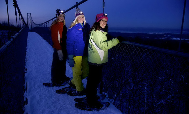 Guided night snowshoe hike across Suspension Bridge