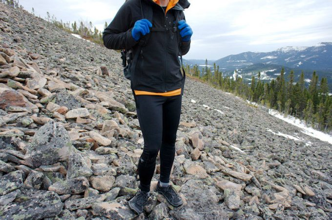 A oerson hiking in tights