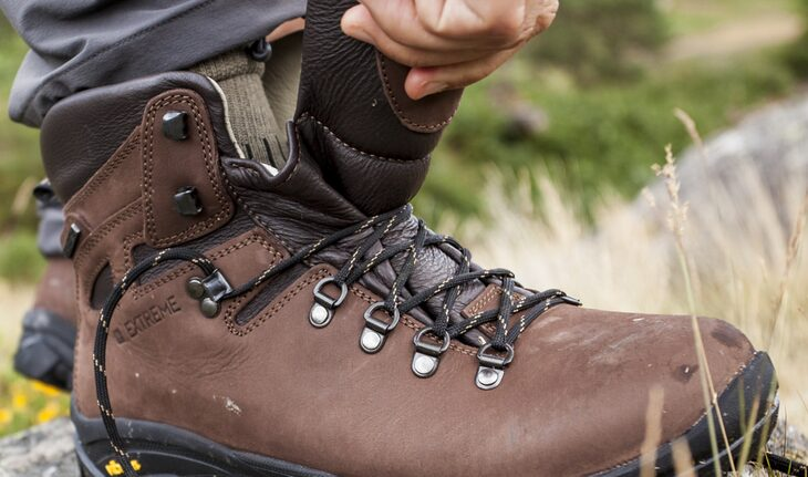 Image of a person checking the hiking boots