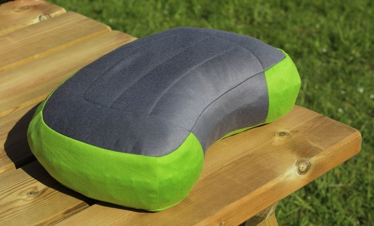 A pillow on a wooden table