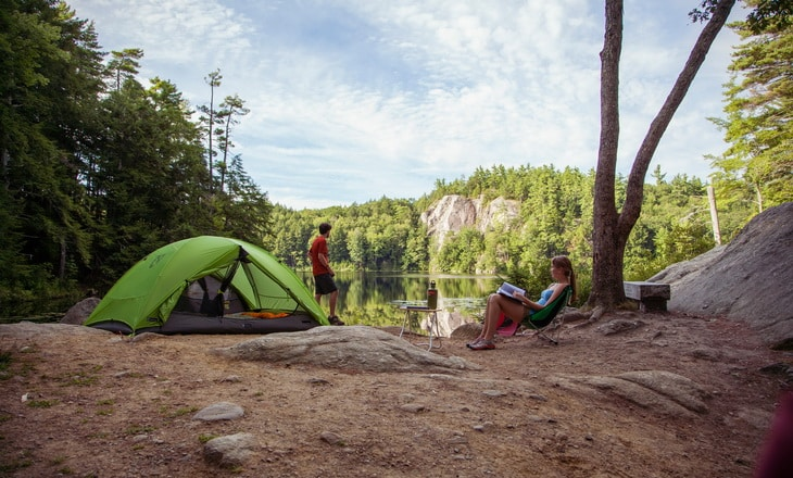 Two people camping in the forest