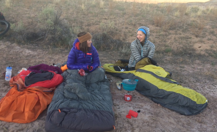 Two womens in sleeping bags outside