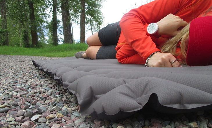 Woman laying down on Klymit-Static-V-Luxe-sleeping pad