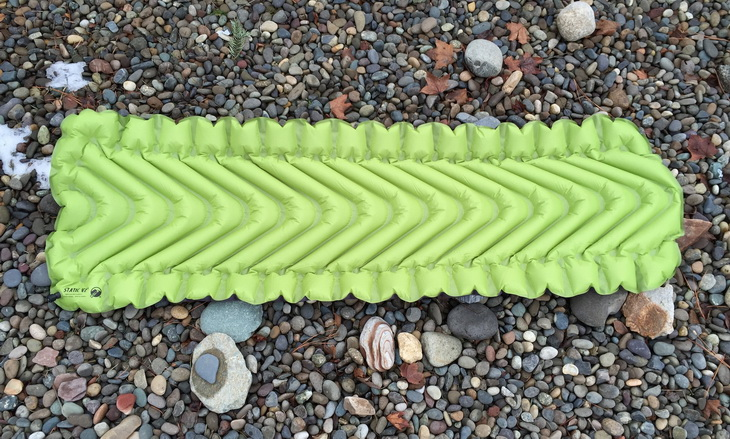 Klymit Static V2 Inflatable Sleeping Pad on rocks outside