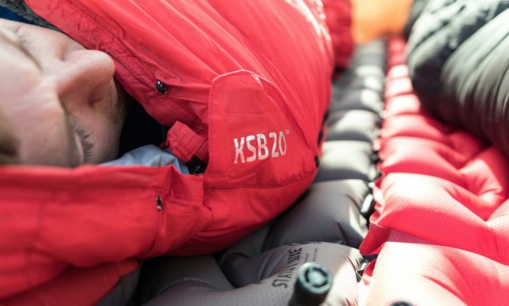 Man sleeping in Klymit KSB 20 Sleeping Bag