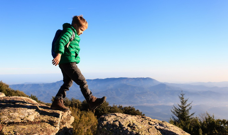 Little kid hiking in the backcountry