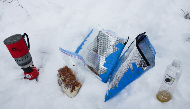 insulated pouches and some food on the snow