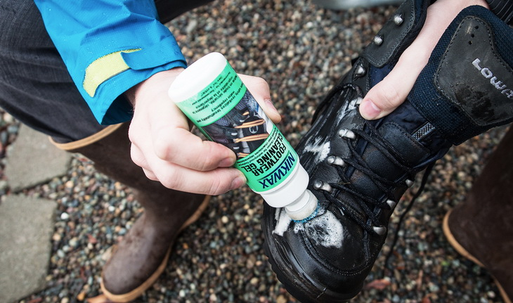 Man Reproofing Hiking Boots