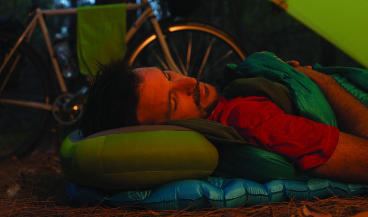 Man sleeping on Sea to Summit Ultralight Mat