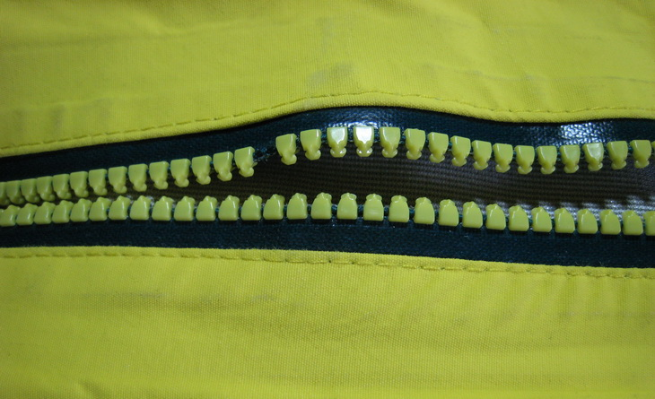 Missing tooth on a waterproof vislon zipper.