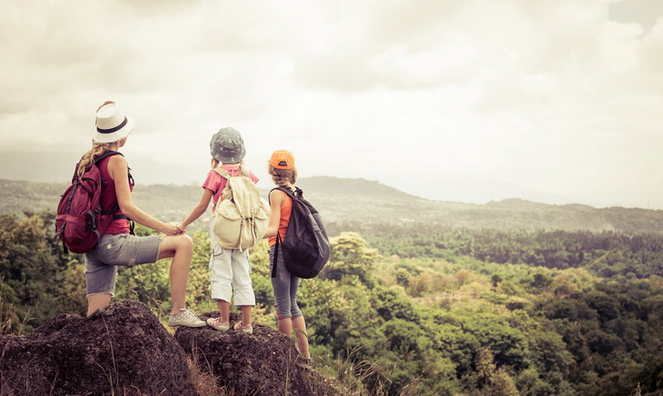 Mother hiking with her childrens