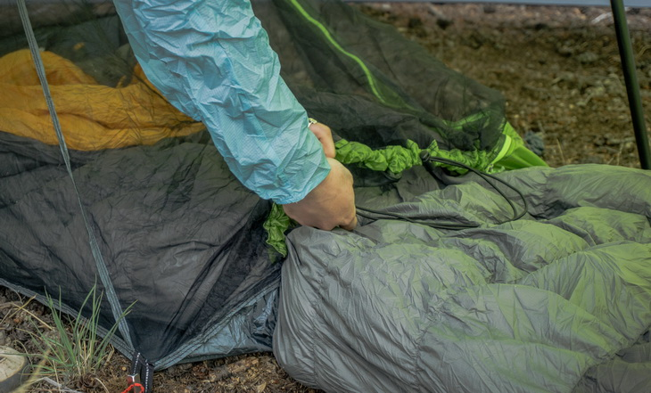 A person holding the Nemo sleeping bag
