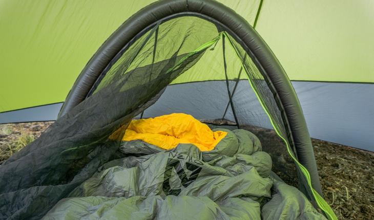 Nemo Tango Solo Down Comforter in a tent