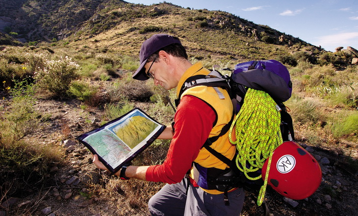 Backpacker looking at a map