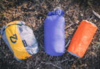 Nemo next to another 2 sleeping bags in storage sacks