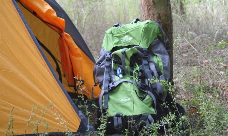 Teton Sports Escape 4300 Ultralight Internal Frame Backpack near a tent
