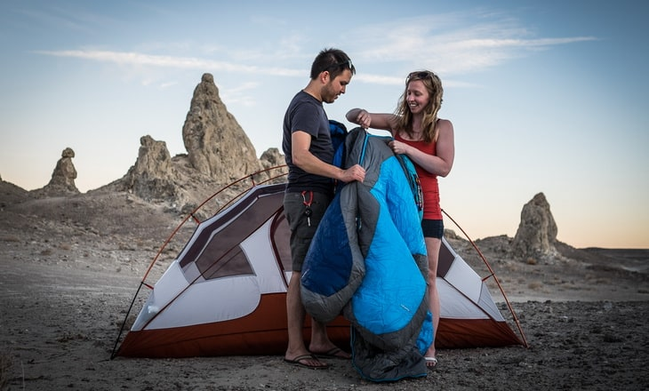 A couple camping in the wilderness