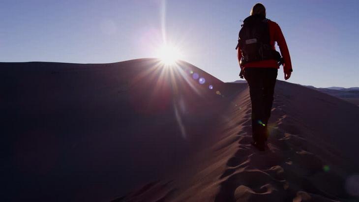 Trekking woman walking success desert