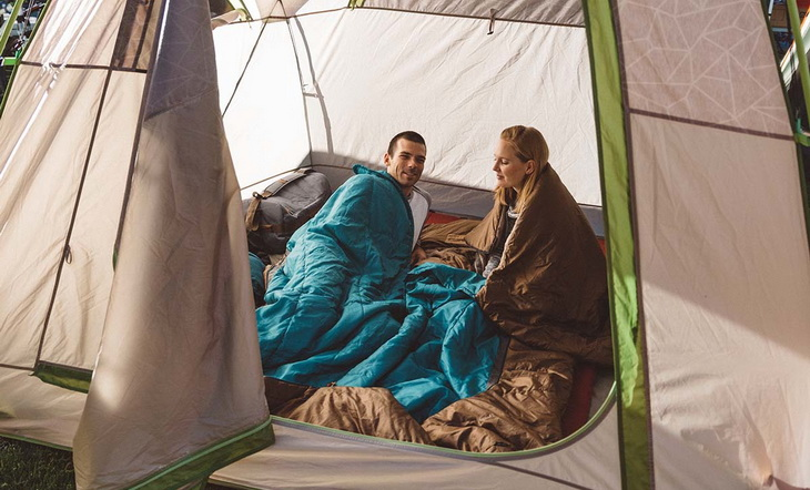 A couple italking to each other in the tent