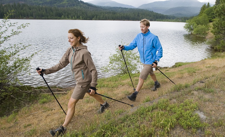 Two adults using Walking Poles