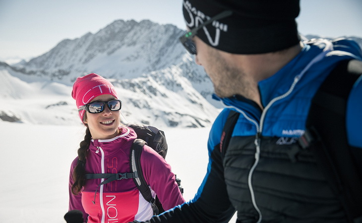 Two adults wearing Primaloft insulated jackets
