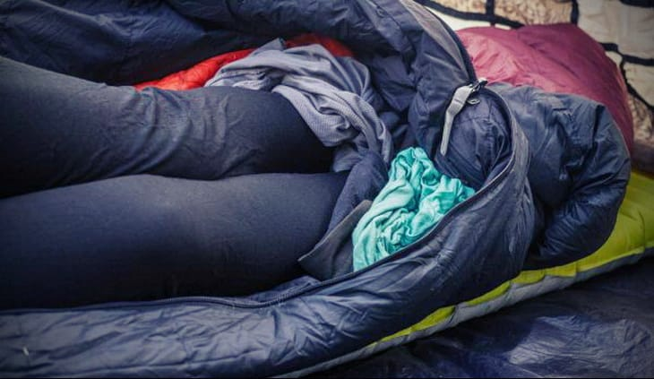 Use garbage can science to help keep your stuff dry. Line your backpack with a plastic garbage bag and fill 'er up.