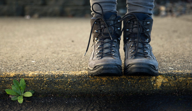 Image of a person sitting in hiking boots