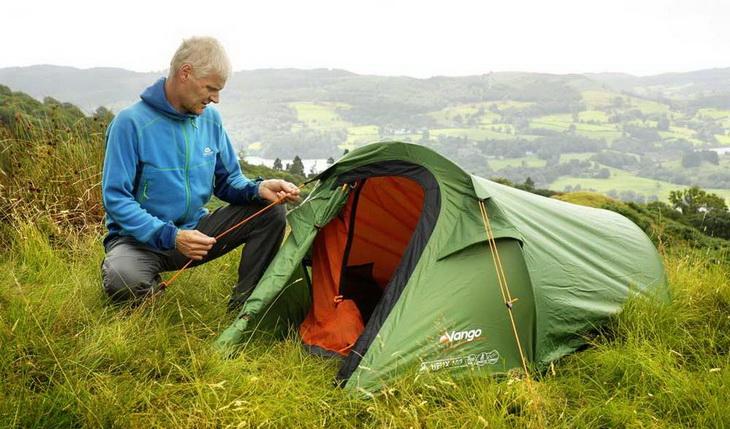 A man setting up Vango Helix 100 solo tent