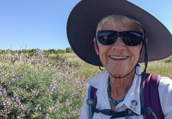 A hiker with eye protective sunglasses