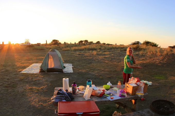 A woman camping at Prairie Creek Campground