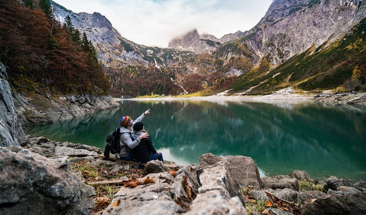 Couple hiking in Alps mountains