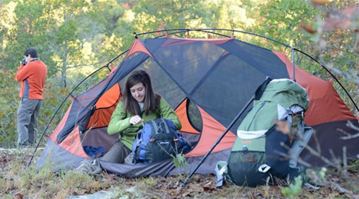 Two person camping in nature with alps mountaineering tent